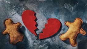 Subject in the form of heart is broken on two halves with the little toy men symbolizing, concept of broken love. Subject in the form of heart is broken on two stock image