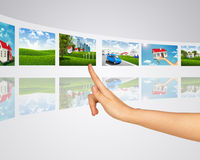 Subject homes for sale. Finger presses one of Stock Photo