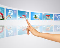 Subject homes for sale and rent. Finger presses Stock Photo