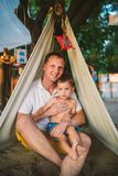 Subject Parenting, summer vacations, father and little son. Young Caucasian dad plays with child on playground in yard. Daddy and. The kid in tent teepee wigwam royalty free stock photography