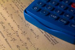 Calculator close up on a background of the scientific literature royalty free stock photos