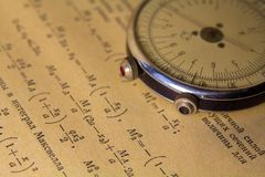 Logarithmic ruler close up on a background of the scientific literature royalty free stock photos