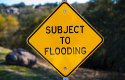 Subject to Flooding Sign. Yellow Subject to Flooding Sign stock photo