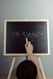 Subject written in white chalk on a black chalkboard Royalty Free Stock Images