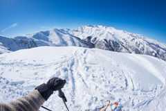 Subjective personal view of alpin skier on snowy slope ready to start skiing. Expansive fisheye panorama of the italian Alps with Royalty Free Stock Photos