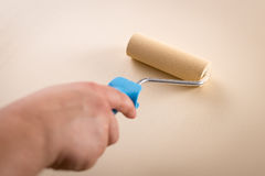 Subjective view of a hand roller-painting Stock Photo