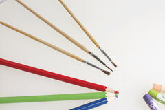 Subjects for creativity: pencils, brushes and pastels Royalty Free Stock Photos