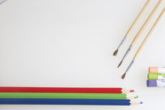 Subjects for creativity: pencils, brushes and pastels Royalty Free Stock Images