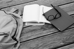 Subjects student -glasses, notebooks, Tablet,black -white photo. Subjects student -glasses, notebooks, Tablet, on wooden floor,black - white photo Stock Images