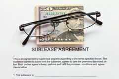Sublease agreement with Dollar notes and key Stock Photos