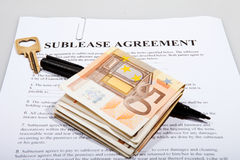 Sublease agreement with Euro notes key and pen Stock Photo
