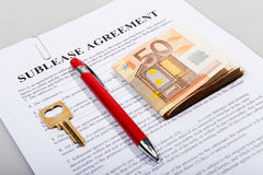 Sublease agreement with Euro notes key and pen Royalty Free Stock Photography