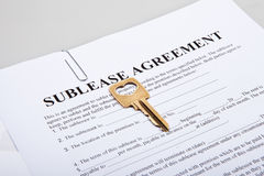 Sublease agreement with golden key Royalty Free Stock Photos