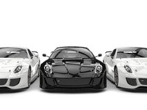 Sublime modern black and white sports cars - side by side Royalty Free Stock Photo