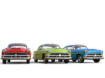Sublime vintage cars in red, green and blue. Isolated on white background Stock Image
