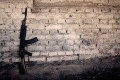 Submachine gun kalashnikov AK-47 against the wall. Old submachine gun kalashnikov AK-47 against the wall Royalty Free Stock Photos