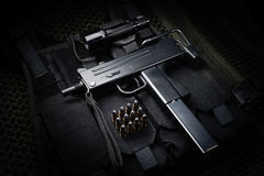 Submachine gun. And 9mm round laid on a tactical vest Royalty Free Stock Photo