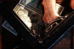Submachine Gun And Money. Old USA submachine gun closeup near one dollar bank notes Royalty Free Stock Images