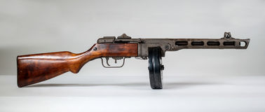 Submachine gun ppsh-41 on a light background. Royalty Free Stock Photography