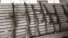 Submachine guns rack full of beautiful Soviet made craftsmanship. Cambodian civil war weapons in war museum. These submachine guns are the PPSh-41 and PPs-43 Royalty Free Stock Photography