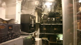 Submarine communication room. HONOLULU, OAHU, HAWAII, USA - AUGUST 21, 2016: communication room with speakers and radios of USS Bowfin Submarine SS-287 at Pearl stock footage