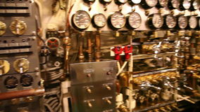 Submarine control room. HONOLULU, OAHU, HAWAII, USA - AUGUST 21, 2016: detail of all levers and speedometers in the machine room of USS Bowfin Submarine SS-287 stock footage