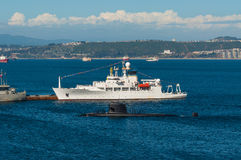 Submarine with crew and oceanographic survey ship Royalty Free Stock Image