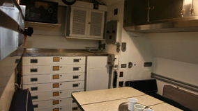 Submarine dinning room. HONOLULU, OAHU, HAWAII, USA - AUGUST 21, 2016: dinning room with food storages of USS Bowfin Submarine SS-287 at Pearl Harbor. Historic stock footage