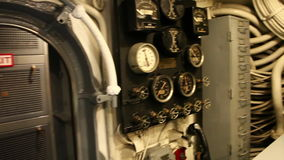 Submarine exit door. HONOLULU, OAHU, HAWAII, USA - AUGUST 21, 2016: exit door from control room in USS Bowfin Submarine SS-287 at Pearl Harbor. With levers and stock footage