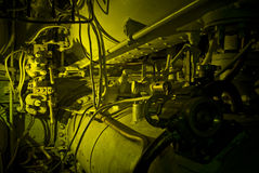 Submarine machinery. The interior of an old submarine, complicated machinery, green light stock photo