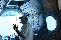 Submarine pilot in Atlantis VI Submarine in Port of Aruba Royalty Free Stock Photos