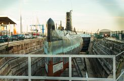 Submarine in reparations. Lisbon, Portugal. 8 December 2018. Old Portuguese Navy submarine being repared in dry docks, deactivated from service, will be a museum stock image