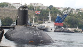 Submarine returns to base. From the open sea to the bay stock video footage