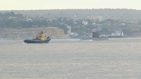 Submarine returns to base. From the open sea to the bay stock footage