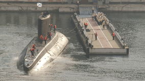Submarine returns to base stock video