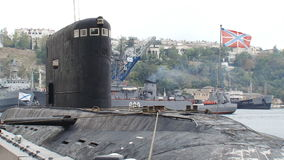 Submarine returns to base. From the open sea to the bay stock video