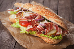 Submarine sandwich with bacon Stock Images