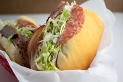 Submarine Sandwich. An Italian submarine sandwich in a red plastic basket Royalty Free Stock Photography