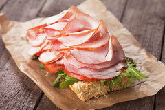 Submarine sandwich with smoked ham Royalty Free Stock Photos