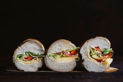 Submarine sandwiches sliced Royalty Free Stock Photo