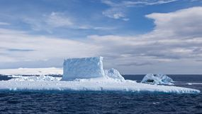 Submarine Shaped Iceberg in Antarctic Ocean Stock Image