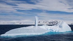 Submarine Shaped Iceberg in Antarctic Ocean Royalty Free Stock Image