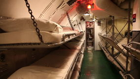 Submarine sleeping room. HONOLULU, OAHU, HAWAII, USA - AUGUST 21, 2016: sleeping room with camp beds of USS Bowfin Submarine SS-287 at Pearl Harbor. Historic stock footage