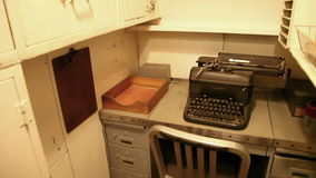 Submarine small office. HONOLULU, OAHU, HAWAII, USA - AUGUST 21, 2016: small office with lockers, desk and teletypewriter in USS Bowfin Submarine SS-287 at Pearl stock footage