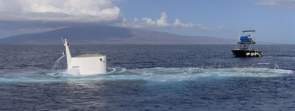 Submarine surfacing. Tourist submarine surfacing near Lahaina, Maui, Hawaii, USA stock photo