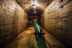 Submarine torpedo in old Soviet underground warship ammunition depot Stock Images