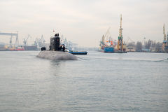 Submarine. Towing with the Shipyard underwater Eagle Navy port in Gdynia stock photos