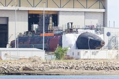 Submarine under construction in a naval shipyard Stock Image
