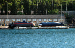 Submarines on dry dock Stock Images