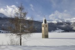 Resia iced lake and tower bell Royalty Free Stock Photos